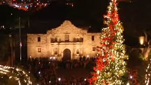 large christmas city moving christmas tree out of alamo plaza woai