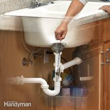 How To Unclog A Bathtub Drain Full Of Hair Unclog A Kitchen Sink Family Handyman