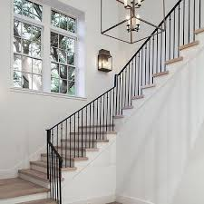 mixed iron staircase spindles transitional entrance foyer