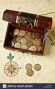 Map With Compass Open Treasure Chest Box On Old Map With Compass Rose Stock Photo