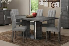 round white dining table with gray dining chairs contemporary