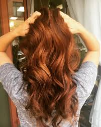 long wavy pumpkin spice colored hair pumpkin colored hairstyles