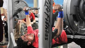 how much does a bench press bar weigh reference com