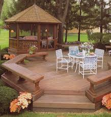 deck backyard ideas open freestanding deck with bench seating plus a screened gazebo