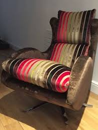 Designer Swivel Chair - orange fabric from the customers attic made a quirky inside seat