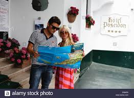 Maps For Directions Young Couple Looking At A Map For Directions Positano Campania