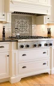 tile medallions for kitchen backsplash simple clean field tiles with bold medallion detail above cooktop