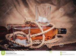 whiskey photography whisky glass with ice a bottle of whiskey and a stock image