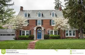 brick house with flowering dogwood trees stock photo image 90819997