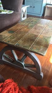 Wagon Wheel Coffee Table by Vintage Wagon Wheel Coffee Table Decoupaged With Maps Ginger U0027s Attic