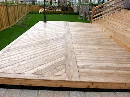 Wood Patio Deck Designs Wood Slabs Were Installed In Directions To Form Specific Design