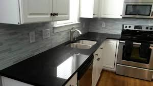 modern white kitchen with glossy black kitchen countertop pictures