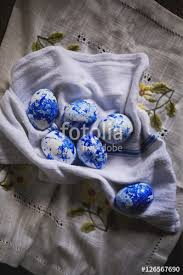 painted eggshells painted eggshells on white cloth stock photo and royalty free