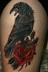 true realistic raven bird and rose flower tattoo on shoulder