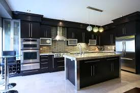 kitchens with dark cabinets and white appliances round stone above