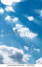 blue sky clouds sun rays stock photo 73037842