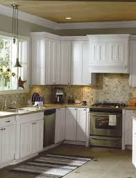 a corner kitchen with a runner along the floor in front of the