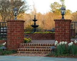 privacy fencing with brick and iron landscape landscape design