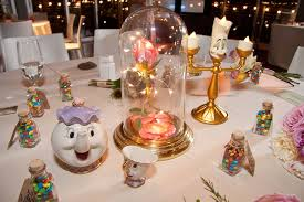 beauty and the beast wedding table decorations each table at this couple s wedding was inspired by a different