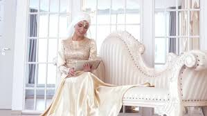 gold wedding gown portrait of a beautiful muslim in gold wedding dress with