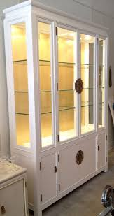 lighted mid century white and gold leaf china cabinet by century
