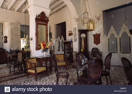 the interior and furniture of a typical colonial home dating from