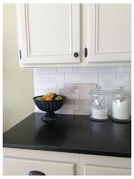 what color cabinets with beige tile beige kitchen cabinets with white subway tile design do or