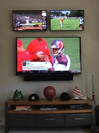 Undercounter Flat Screen Tv by The Ultimate Multiple Screen Tv Wall In His Sports Room