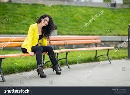 beautiful sitting on park bench stock photo 313194809