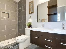 contemporary full bathroom with limestone counters u0026 double sink