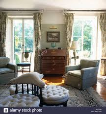 upholstered victorian loveseat in centre of country livingroom