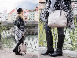 street riding boots day trip to innsbruck austria fair isle poncho cashmere scarf