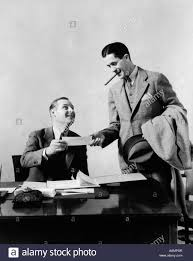 Two Desks In One Office 1930s Two Men At Desk In Office One Man With Cigar Exchanging