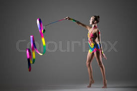 ribbon dancer beautiful happy cool fit gymnast athlete woman in colorful