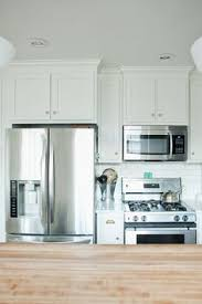 Arcadia Cabinets Lowes White Shaker Lowe U0027s Arcadia Cabinets Frame A Ge Stainless Steel