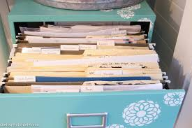 how to organize a file cabinet system organizing paperwork with a colour coded file system the happy housie