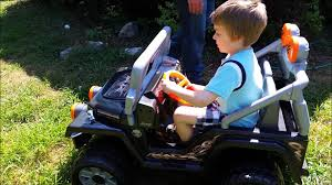 baby jeep wrangler baby and six year old get fisher price power wheels tough talking