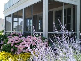 how to layer plants in a garden landscaping design
