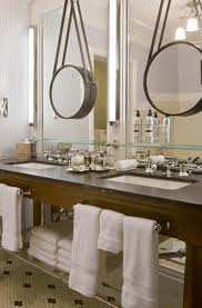 frameless picture hanging circle hanging mirror cream floor tile with black square pattern