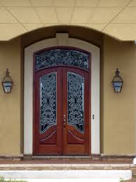beautiful custom wood door with leaded glass windows and arch top