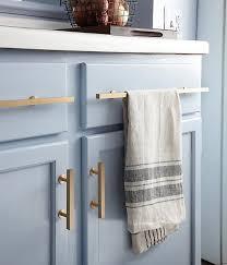 navy blue kitchen cabinets with brass hardware kitchen details brushed brass cabinet pulls against light