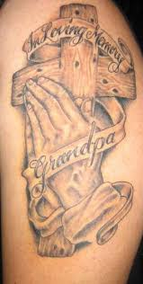 tattoos of holding praying and cross