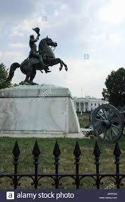 statue of soldier on a horse and the white house residence of the