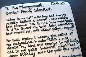 man quits job with resignation letter on a cake eater