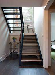 Switch Back Stairs by Cedar Porch House Transforms Peripheral Element Into Focal Point