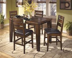 butterfly dining room table larchmont butterfly ext table 4 uph bar stools d442 124 4 32