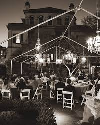 outdoor party tent lighting vintage french chandeliers hang from a tent frame urban wedding