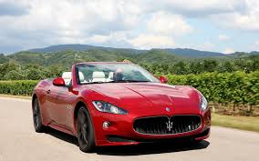 red maserati red maserati grancabrio on the background of green hills wallpaper