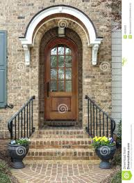 front doors front door architecture brown arched glass front