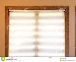 wooden window blinds image of classic wood window blinds mini blinds on wood window frame royalty free stock photos